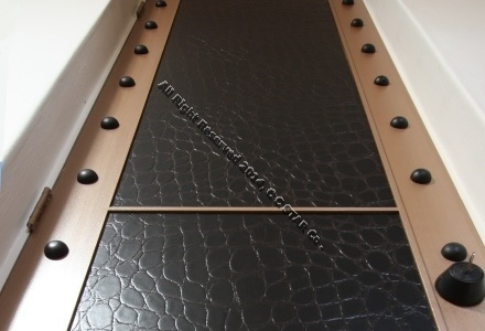 An idea to use leather covered sheet in door
